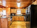Spacious Kitchen with Breakfast Bar and Fully Equipped for Enjoying Meals in with the Family.
