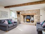 Stylish living room, with roaring log burner