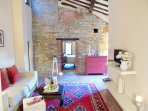 Characteristic living and lounging room with Medieval stone wall tower