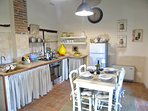 Typical Tuscan stone built kitchen, rustic but fully equipped.