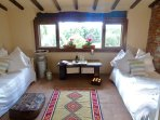 The loggia with large open recces and day beds for lounging and relaxing