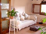 The summer room (loggia) with comfy day beds and views over the hills