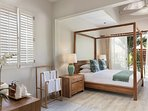 Spacious main en-suite bedroom complete with king-size four-poster teak bed and balcony.