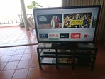 50' TV with Apple TV, Netflix contract, soundbar with Bluetooth connection