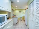 Fully equipped kitchen with spacious pantry storage.