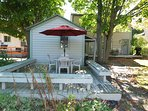 Back Deck:  Includes outdoor dining table, chairs, and umbrella.
