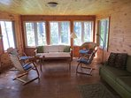 Spacious sunroom. Great spot for family gatherings, games or reading. Sofa opens into double bed.