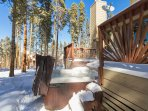 Hot tub in quiet wooded setting and ski area views off back deck