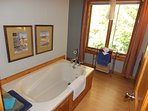 Bathroom #2 (upstairs):  Features a jacuzzi tub, toilet, dual sinks, and a large window with blinds.