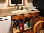 First extinguisher under sink.