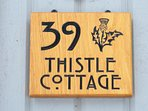 K39 Thistle Cottage - Entrance Sign (Now painted grey)