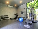 Fitness area with a variety of workout equipment.