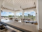The seasonal Beach Club open air  bar with sweeping views of the Galveston Bay and the gulf.