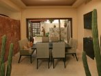 Dining Room w front courtyard entrance