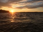 Sunset over Torch Lake from the dock at Dockside Restaurant, a ten minute walk or boat ride away.