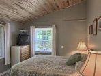 The main bedroom has one queen bed.