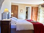 Garden level twin bedroom with ensuite bathroom & doors to garden +1mtr thick stone walls+13thC arch