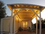 Covered parking also provides nice outdoor space with gas grill and more adirondack chairs