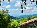 View from the garden to the distant Cantal mountains