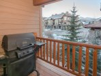 Rear deck off of dining area with gas grill and mountain peak views