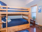 Third bedroom with full size bunk beds located on lower level