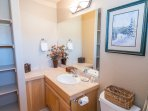 Wrap around vanity and ample shelving in Master bathroom
