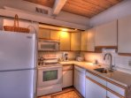Prepare meals in the fully-equipped, open-plan kitchen.