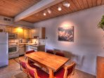Guests can enjoy meals or entertain at the dining table, complete with 6 chairs.