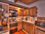 Prepare meals in the fully-equipped kitchen.