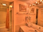 The full bathroom features a separate shower-tub combination and vanity.