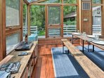 Wine and dine at the picnic table in the sunroom.