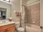 The second bedroom has a shower/tub combo.