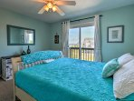 This colorful room has a queen bed and an abundance of natural light.