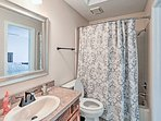 The third en-suite bathroom is equipped with a shower/tub combo and single vanity.