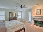 Enjoy cozy nights in the master bedroom, equipped with a queen bed and wood-burning fireplace.