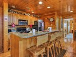 Hearty meals await to be prepared in the fully equipped kitchen that boasts stainless steel appliances and granite...