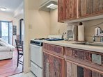 Prepare small meals in the galley kitchen adjacent to the living room.