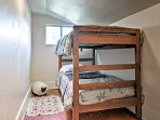 Jump into the twin-over-twin bunk bed for peaceful slumbers.
