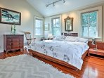 The master bedroom features a plush king bed.