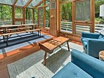 This large sunroom offers a sitting area and dining area.