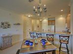 Guests can dine at the table or breakfast bar.