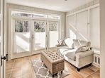 Natural light pours into the sunroom.