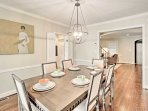 Serve up gourmet meals in the dining room featuring a wood table and seating for 8.