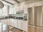 The fully equipped kitchen has everything you need to cook at home including stainless steel appliances.
