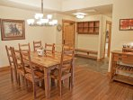 Dining for 10, a wine bar, and entry with bench, storage, and closet