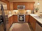 Stainless steel appliances, Gas Range, Slate tile floors
