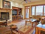 Enjoy a big Living Room with sleeper sofa, fireplace, & HDTV