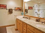 The master bathroom has dual under mounted sinks and granite counters