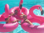 Heated Pool with some inflatables at your disposal, but not all size for kids learning to swim