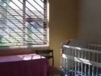 Desk next to crib - work while watching baby.